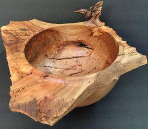 Olive wood bowl with bird carving
